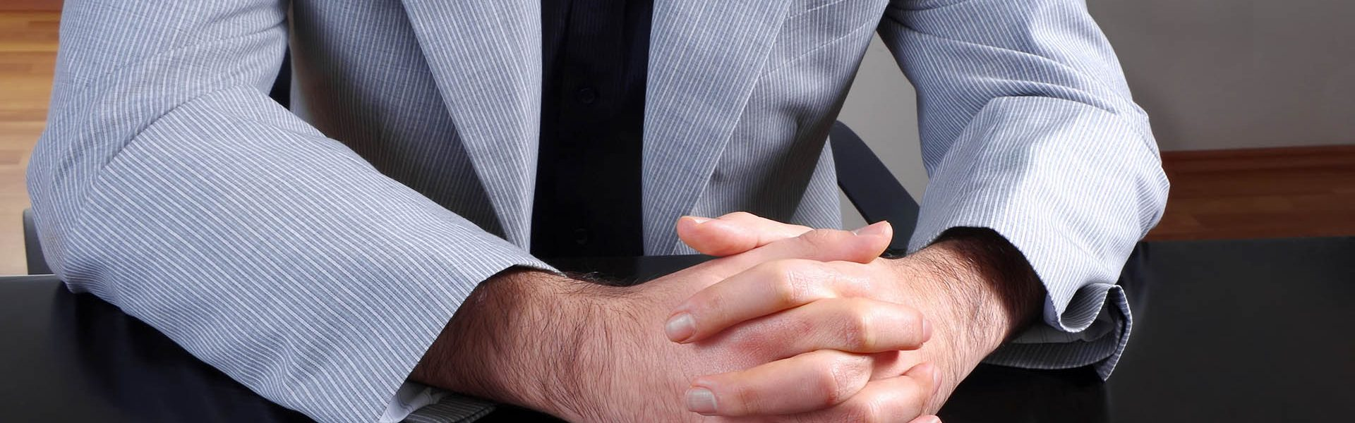young man in office body language waiting listening closeup